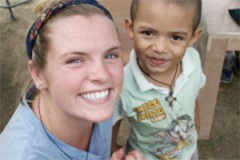 Senior Maggie Lindsey in Costa Rica with one of the young students who will attend a primary school she helped design and build.