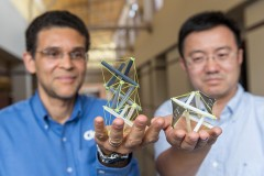 """Georgia Tech researchers Glaucio Paulino, left, and Jerry Qi hold 3-D printed objects that use tensegrity, a structural system of floating rods in compression and cables in continuous tension. They've developed a new way to create structures with """"memory"""" that can expand dramatically when heated. (Photo: Rob Felt)"""