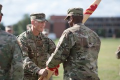 Col. Tom Rickard, BSCE 1990, assumed command of the U.S. Army's Fort George G. Meade August 4. During the change of command ceremony, Rickard passes the garrison colors to Command Sergeant Major Rodwell L. Forbes.